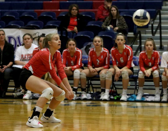 Holliday's Aubrey Miller receives the serve from Jacksboro Tuesday, Oct. 30, 2018, in Graham.