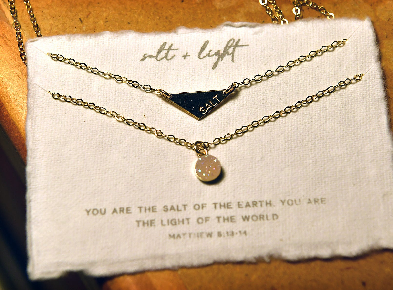 Nichole Kirk's jewelry designs are delicate, faith-based pieces accompanied by a Bible verse printed on hand-made paper.