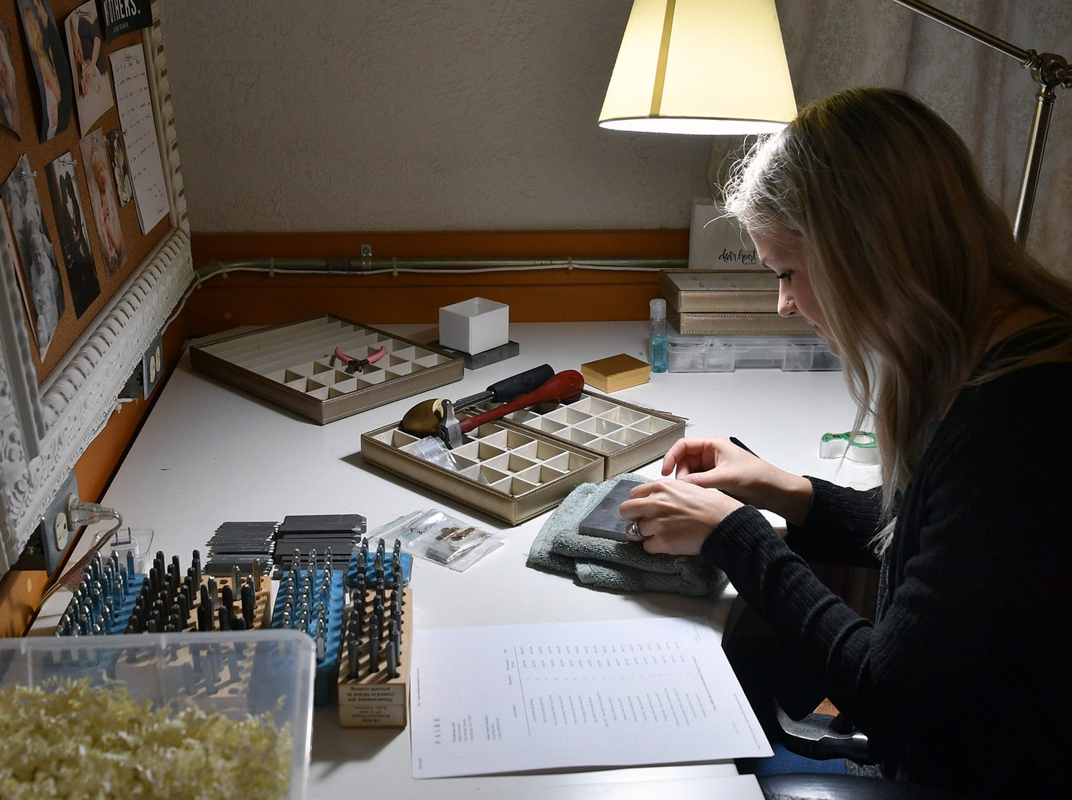 Nichole Kirk makes custom jewelry in her design studio at Dear Heart in Henrietta. Kirk started her business out of her home in 2013.