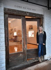 Nichole Kirk, owner of Dear Heart, in the doorway of her first store in Henrietta. Kirk has opened a second location, Ruth & Esther, for her jewelry and apparrel business on Kemp Boulevard in Wichita Falls.