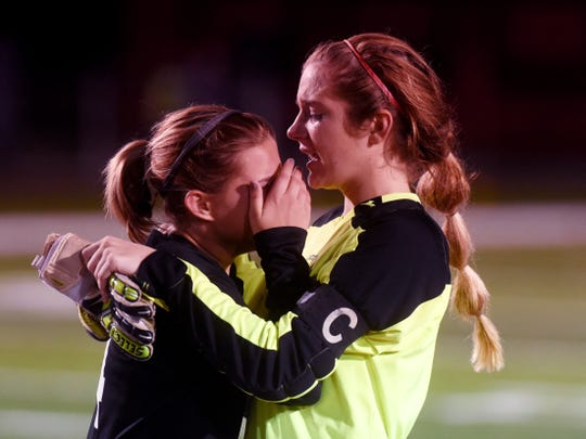 River View's Lexi Fry, left, is consoled by teammate Claire Warschauer following a 1-0 shootout loss during Tuesday's Division II district semifinal at Stewart Field in Coshocton.