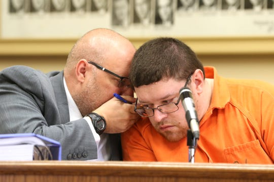 Derek Shaffer consults with his attorney Keith Edwards before pleading guilty to several counts related to sex crimes against children while employed as a teacher at CareyTown Preschool. Shaffer plead guilty in Muskingum County Common Pleas Court on Wednesday.