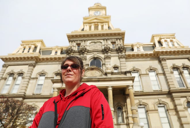 Holly Wilson stands in front of the Muskingum County Courthouse. Wilson was beaten, hogtied and held at gunpoint in retaliation for testifying against a drug dealer, but it was the threat of returning to jail that help her turn her life around. She called court-ordered rehab a blessing in disguise.