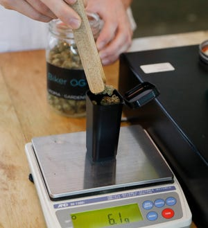 Weighing marijuana buds at a medical dispensary in Detroit.