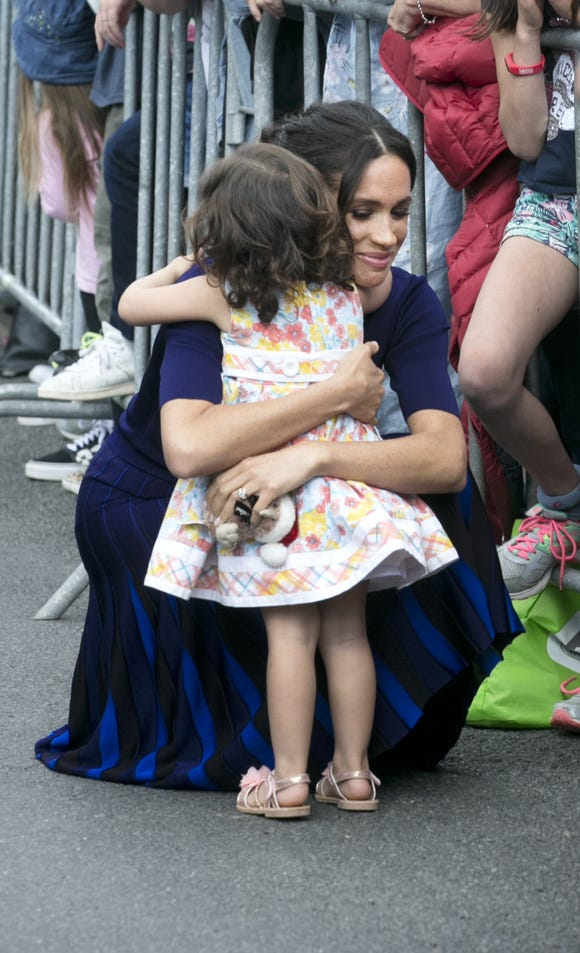 Duchess Meghan hugs a little Catalina Rivera, 2, who got through the railings during a walkabout at Government Gardens on Oct. 31, 2018 in Rotorua, New Zealand.
