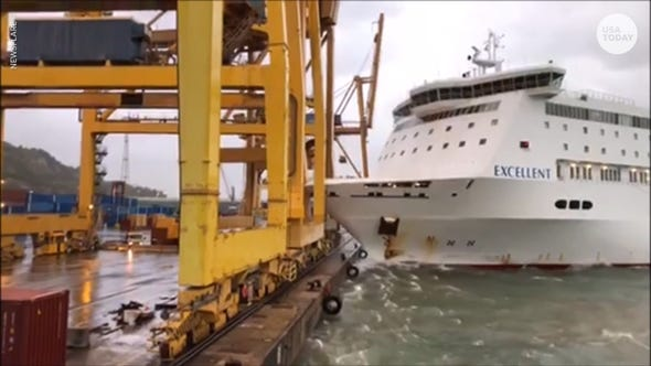 A fire broke out after a ferry crashed into a crane at a harbor in Barcelona, Spain.