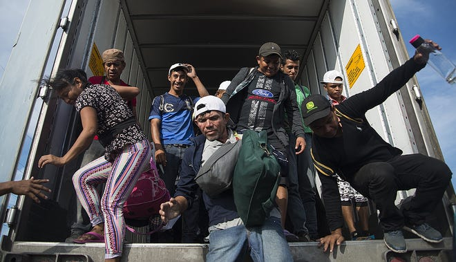 Central American migrants heading to the United States arrive to the municipality of Juchitan, in the state of Oaxaca, Mexico,  Oct. 30, 2018.