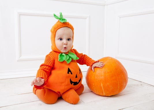Child In Pumpkin Suit