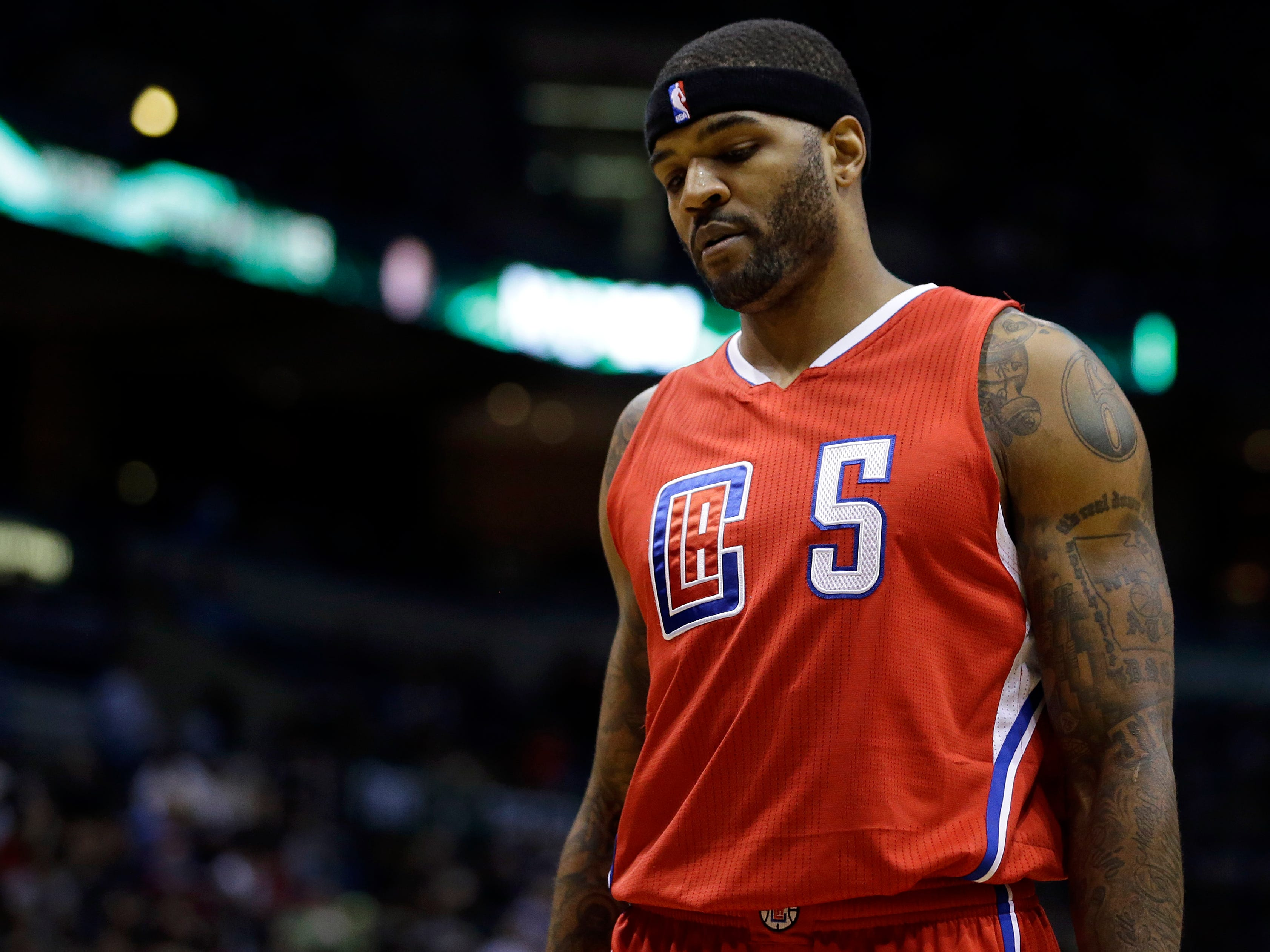 Josh Smith models the Los Angeles Clippers' minimalist look in 2015.
