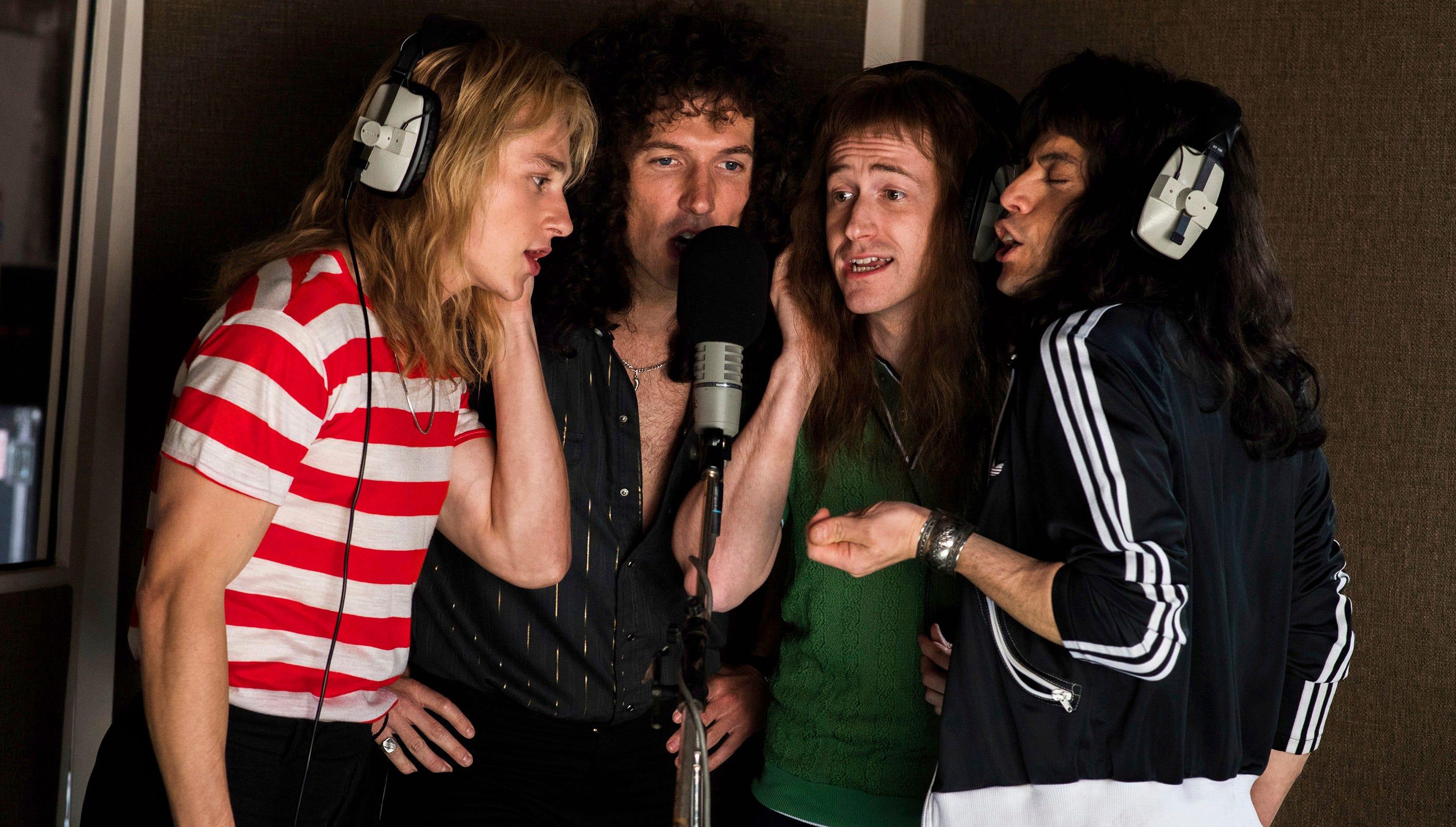 "This image released by Twentieth Century Fox shows, from left, Ben Hardy, Gwilym Lee, Joe Mazzello and Rami Malek in a scene from ""Bohemian Rhapsody."" (Alex Bailey/Twentieth Century Fox via AP) ORG XMIT: NYET727"