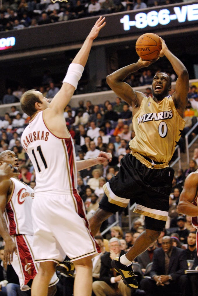 Washington Wizards' Gilbert Arenas shows off this two-tone outfit from 2006.