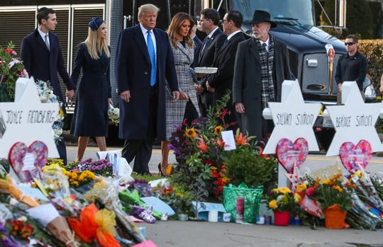 President Trump walks with Melania, Ivanka and son-in-law Jared Kushner, alongside Tree of Life Synagogue rabbi Jeffrey Myers, near the memorial site to the 11 victims in Pittsburgh.