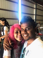 This photo obtained from Facebook posted on June 26, 2017, shows a selfie of Vishnu Viswanath, right, and his wife Meenakshi Moorthy at Skydive Santa Barbara in Lompoc, Calif.