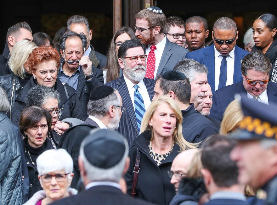 Pittsburgh Mayor Bill Peduto, center striped suit and tie, exits the memorial ceremony for brothers David and Cecil Rosenthal, held at Rodef Shalom Synagogue.