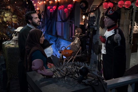 "Dan (John Goodman), on the right, welcomes his neighbors (Alain Washnevsky and Anne Bedian) to a Halloween party on Tuesday's episode of ""The Conners""."