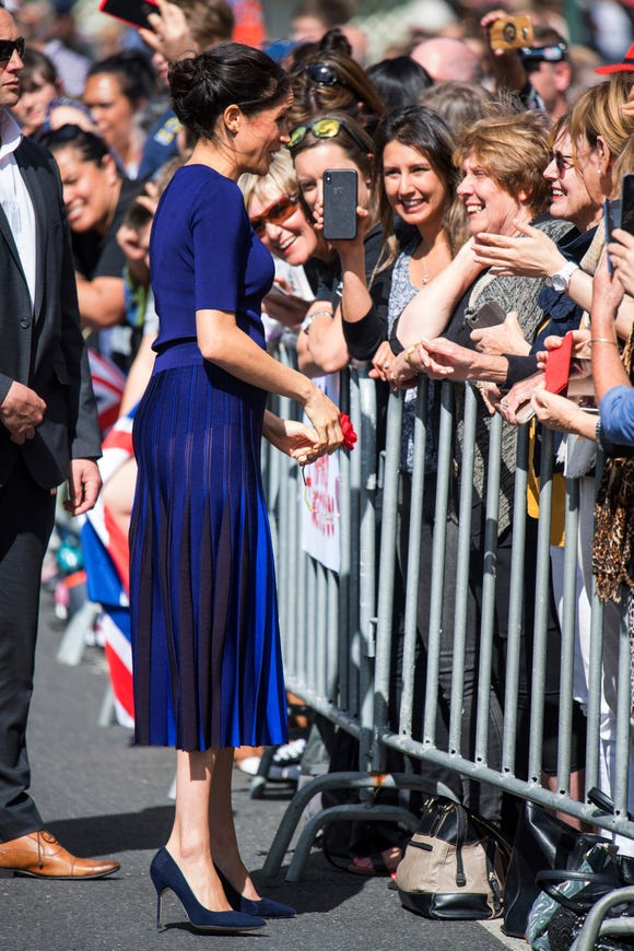 The Duchess of Sussex greets members of the public during a walkabout in Rotorua, New Zealand in what appears to be a see-through skirt.