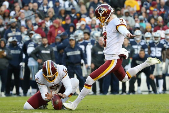 Oct 21, 2018; Landover, MD, USA; Washington Redskins kicker Dustin Hopkins (3) kicks a field goal against the Dallas Cowboys in the third quarter at FedEx Field. Mandatory Credit: Geoff Burke-USA TODAY Sports ORG XMIT: USATSI-381485 ORIG FILE ID:  20181021_gkb_sb4_052.JPG