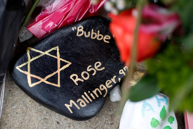 This is a painted rock in memory of Rose Mallinger, 97, found Wednesday, Oct. 31, 2018, part of a makeshift memorial outside the Tree of Life Synagogue in the Squirrel Hill neighborhood of Pittsburgh, to the 11 people killed during worship services Saturday Oct. 27, 2018.