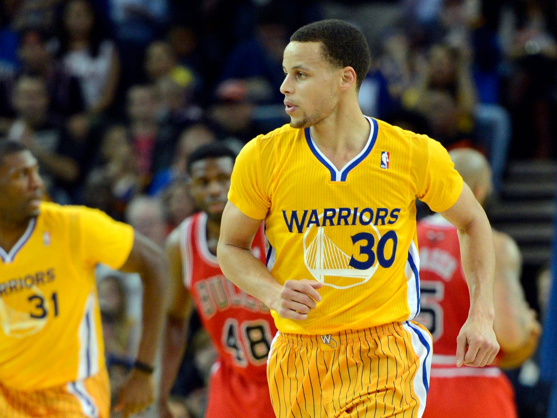 Golden State didn't mean Stephen Curry and the Warriors had to wear uniforms that are so ... gold in 2013.