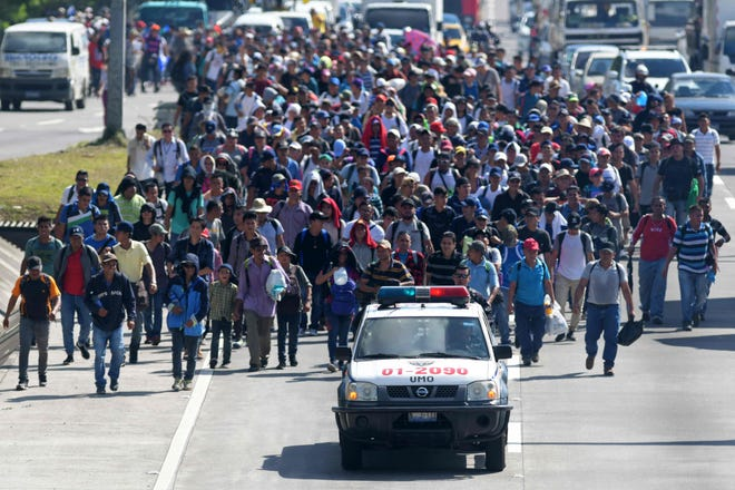 Migrants embark on a journey in caravan to the United States, in San Salvador on October 31, 2018.