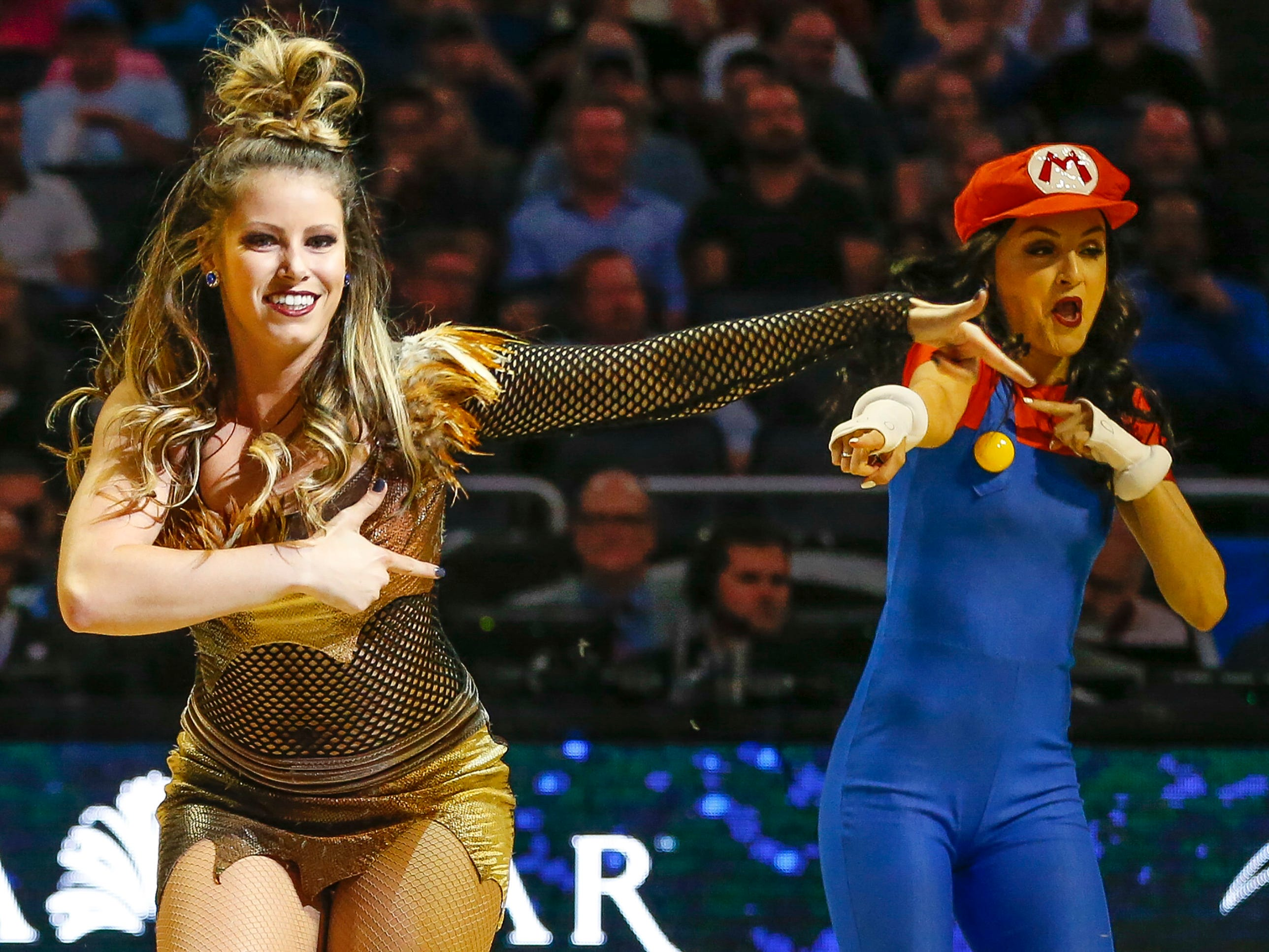 Oct. 30: Magic cheerleaders perform on the court during a stoppage in play in the first quarter of the game against the Sacramento Kings at Amway Center.