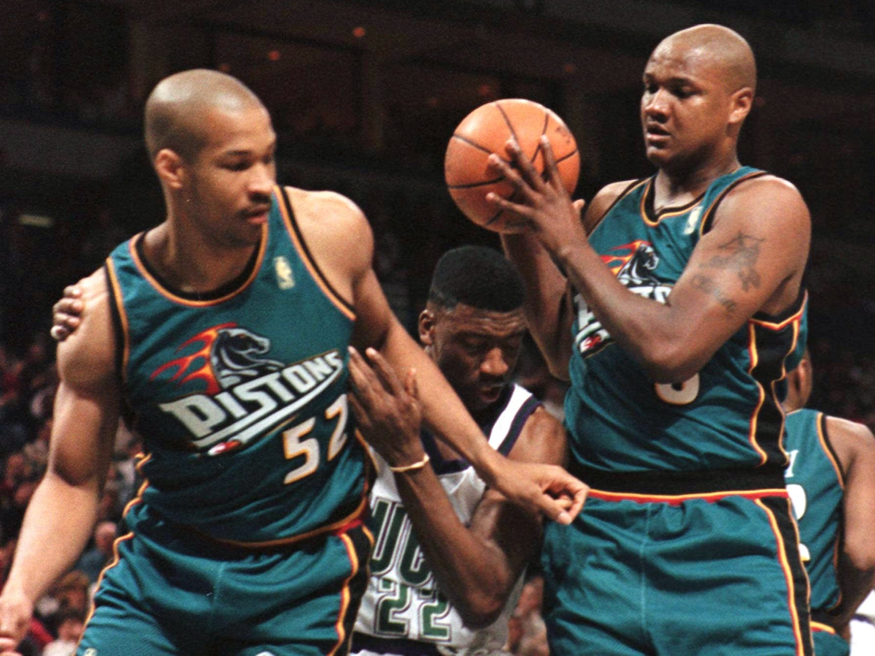 Teal sure was popular in the 1990s, as Don Reid (52) and Terry Mills can attest about the 1996 Detroit Pistons uniform.