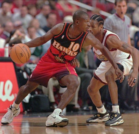 Atlanta Hawks' Mookie Blaylock (10) tries to work his way around Philadelphia 76ers' Allen Iverson in the first half Wednesday, Nov. 5, 1997, in Philadelphia. The Hawks won 93-88. (AP Photo/George Widman) ORG XMIT: PXS101