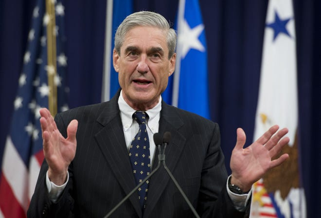 In this file photo taken on Aug. 1, 2013, then-FBI Director Robert Mueller speaks during a farewell ceremony in Mueller's honor at the Department of Justice.
