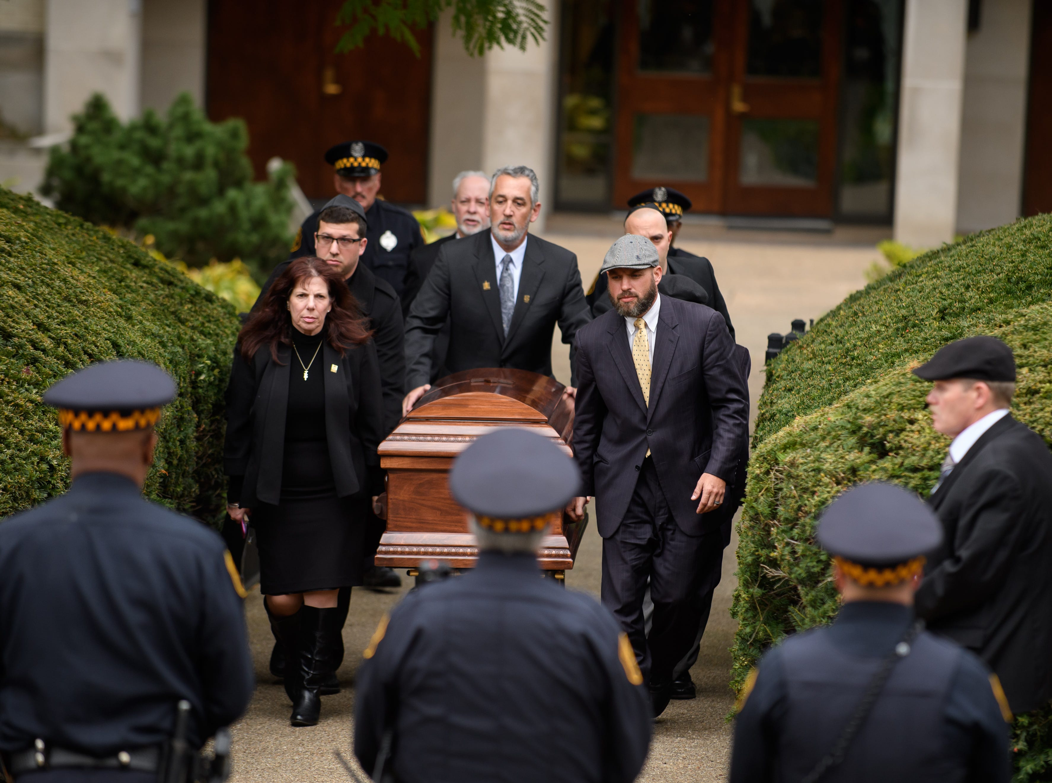 The casket of Irving Younger is led to a hearse outside Rodef Shalom Temple following his funeral on Oct. 31, 2018 in Pittsburgh, Pa. Irving Younger was one of 11 people killed in the mass shooting at the Tree of Life Synagogue on October 27.