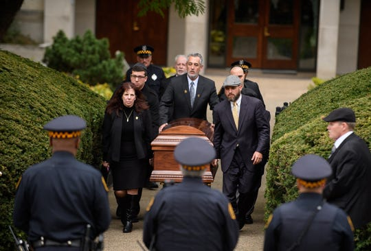 The casket of Irving Younger is led to a hearse outside Rodef Shalom Temple following his funeral on Oct. 31, 2018 in Pittsburgh, Pennsylvania. Irving Younger was one of 11 people killed in the mass shooting at the Tree of Life Synagogue on Oct. 27.