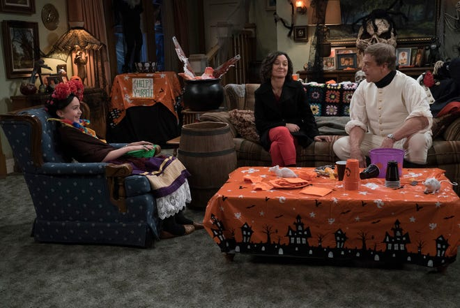 Mark (Ames McNamara), left, is prohibited dressing as Frida Kahlo for his school's Halloween carnival, as Darlene (Sara Gilbert) and Dan (John Goodman) debate a costume ban on Tuesday's Halloween episode of 'The Conners.'