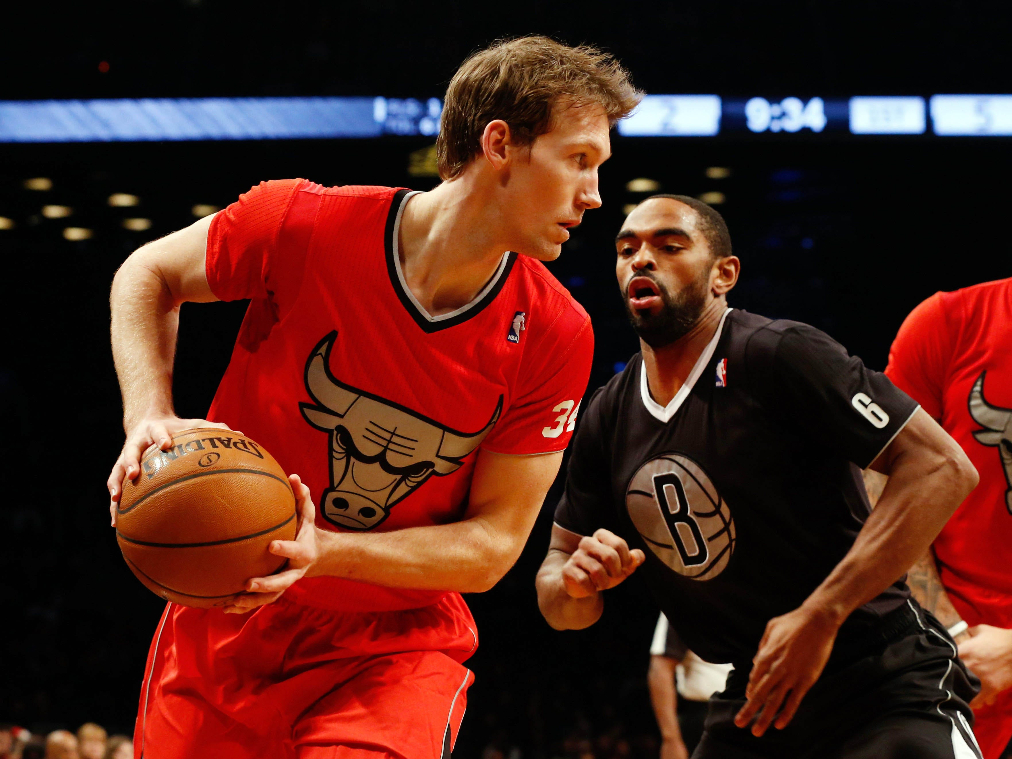 These were the NBA's 2013 version of Christmas sweaters worn by Bulls small forward Mike Dunleavy (left).