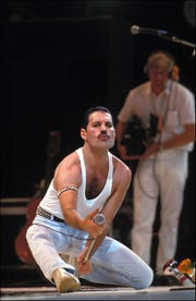Freddie Mercury sings at Live Aid in 1985.