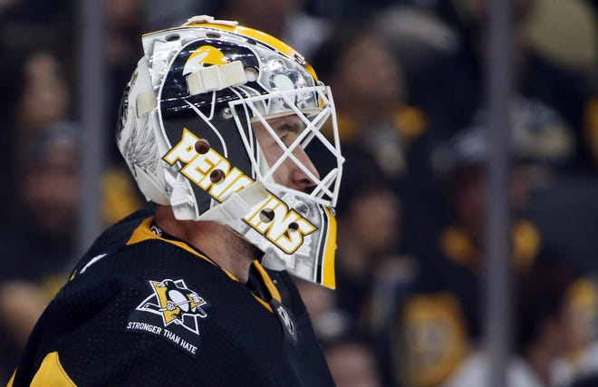Penguins goalie Matt Murray wears a commemorative patch honoring the victims of the killings at the Tree of Life Synagogue.