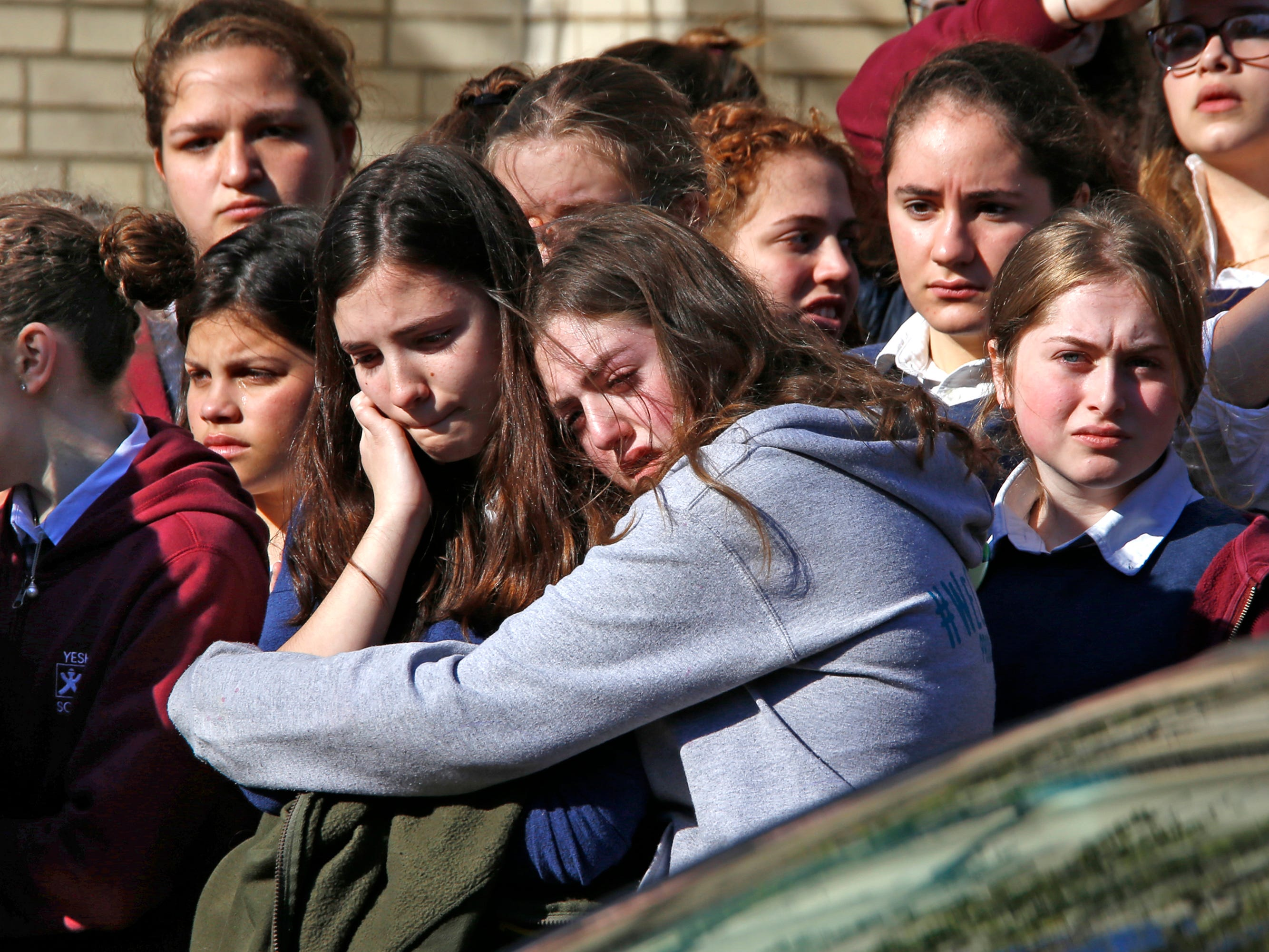 Students from the Yeshiva School in the Squirrel Hill neighborhood of Pittsburgh stand outside Beth Shalom Synagogue after attending the funeral service for Joyce Fienberg, Wednesday, Oct. 31, 2018. Joyce Fienberg, 75, was one of 11 people killed when a gunman opened fire during worship services at the Tree of Life Synagogue on Saturday, Oct. 27.