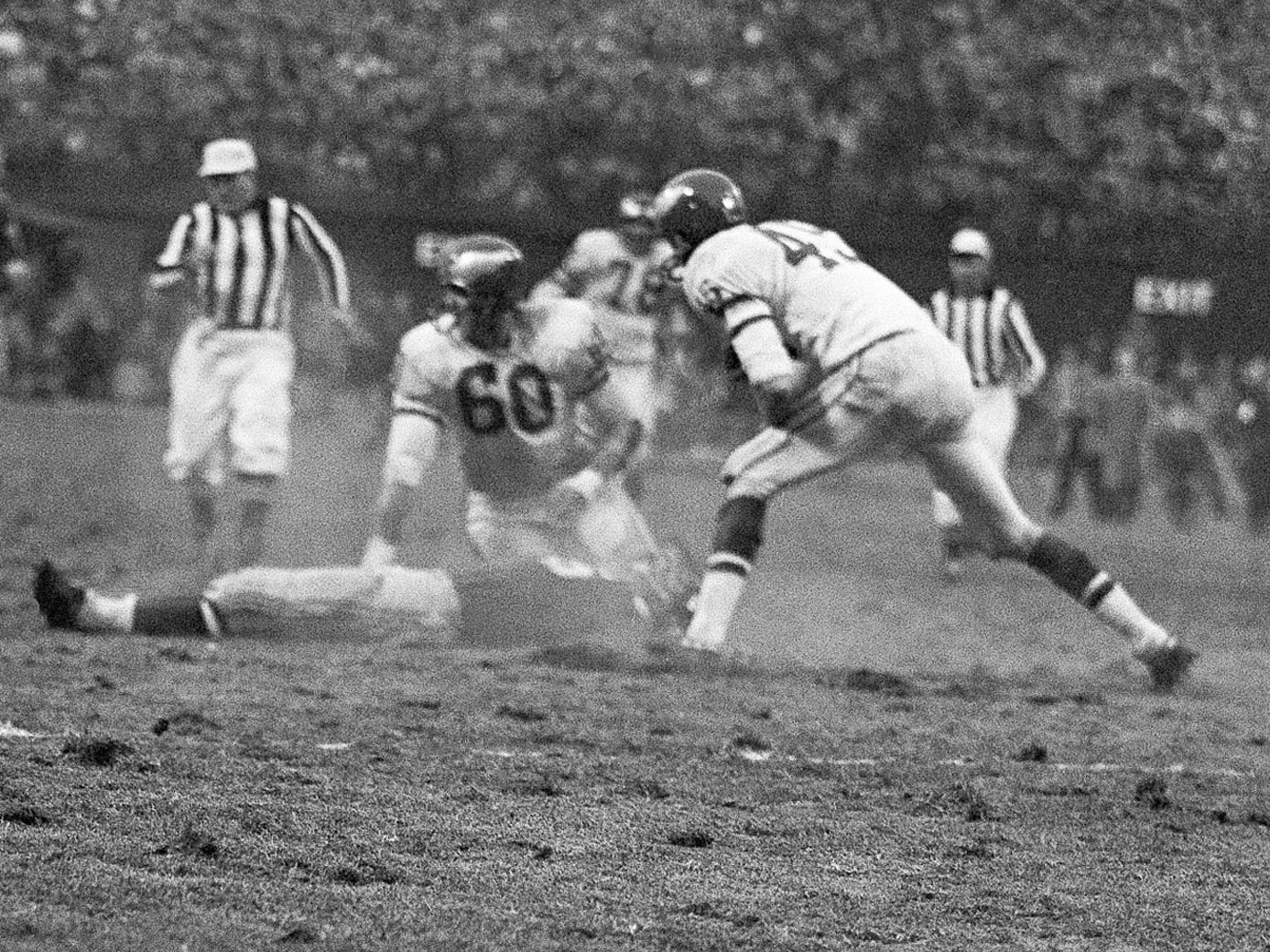 "Chuck Bednarik - ""Concrete Charlie"" known for being the last of the 60-minute men ... and for a crushing hit on Frank Gifford in a game in 1960."