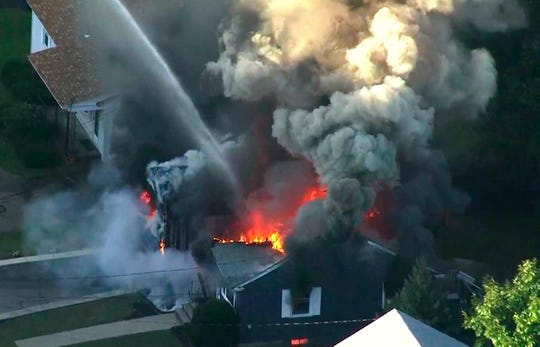 Flames consume the roof of a home following an explosion in Lawrence, Mass, a suburb of Boston on Sept. 13, 2018, in a file image taken from video provided by WCVB in Boston. Federal investigators confirmed that over-pressurized natural gas lines were the source of a series of explosions and fires in communities north of Boston.