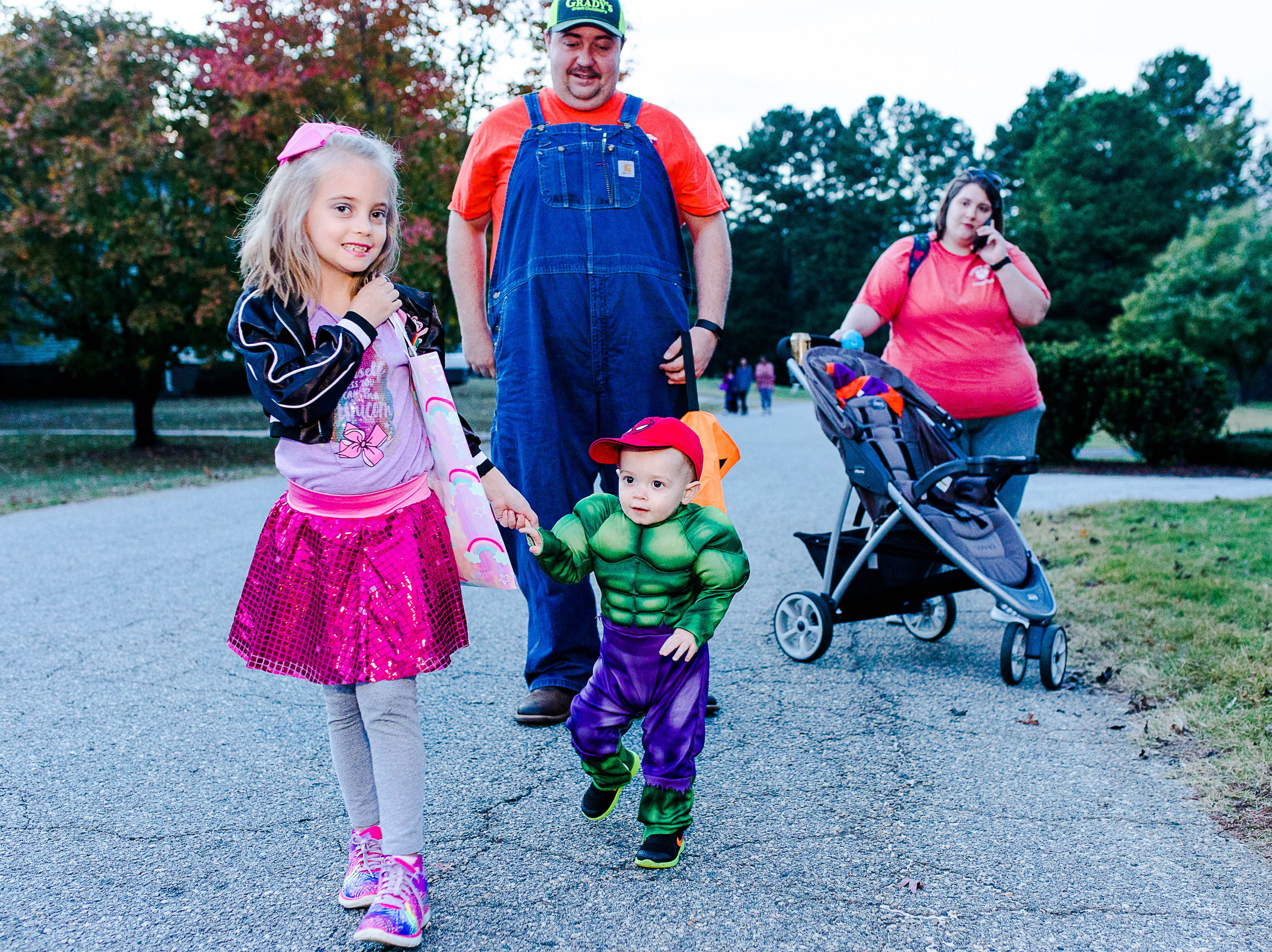 Children enjoy trick-or-treating in the Cobb's Glenn subdivision in Anderson Wednesday, October 31, 2018.