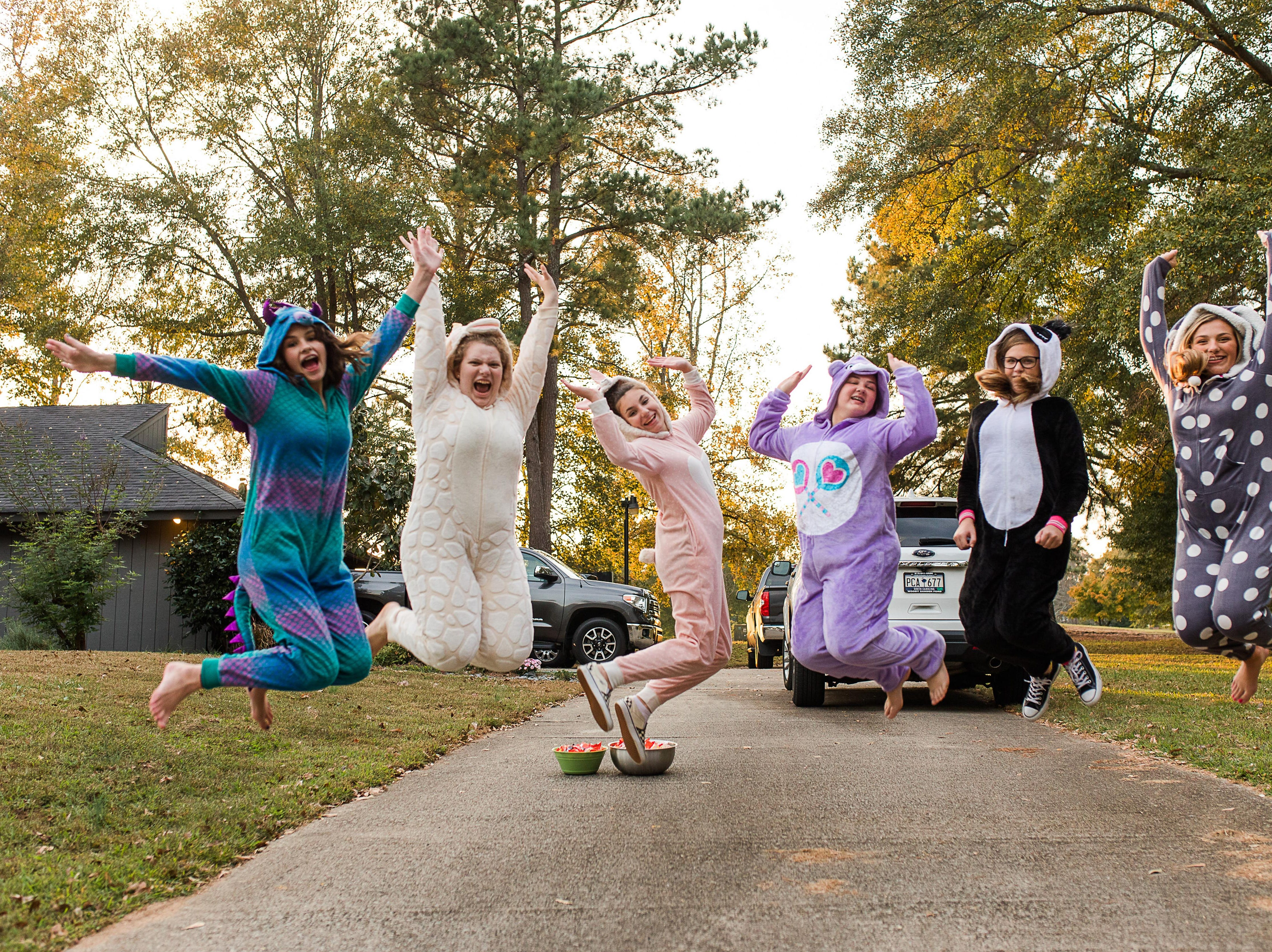 Ella Glenn, Caroline Norris, Molly Sakovich, Cara Flemning, Channing Owens, and Carson Davis  are excited for trick-or-treating in the Cobb's Glenn subdivision in Anderson Wednesday, October 31, 2018.