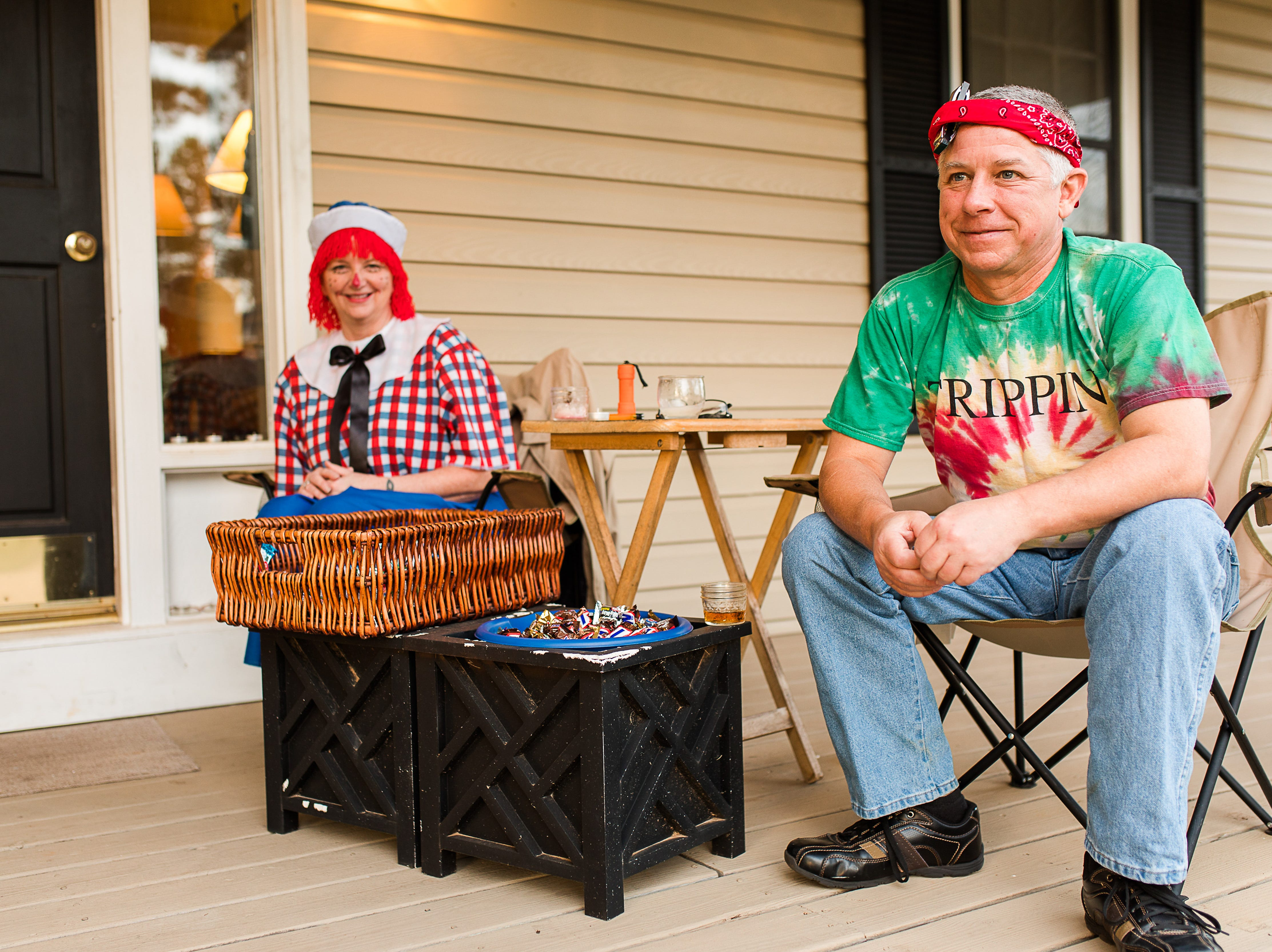 Sandra Reese and Brad Bolt are ready to pass out candy at  the Cobb's Glenn subdivision in Anderson Wednesday, October 31, 2018.