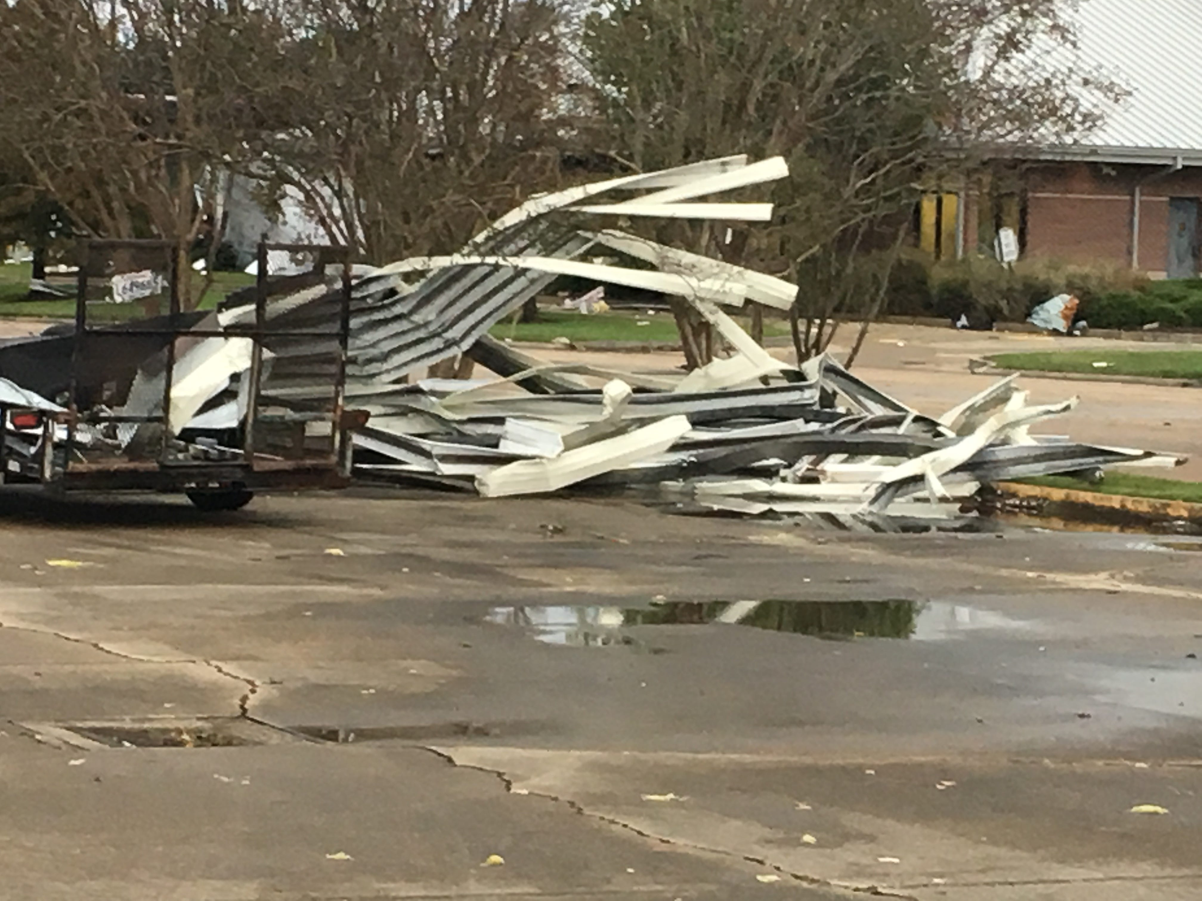 Debris is piled in the parking lot of the Four Seasons Bowling Center on North Boulevard.