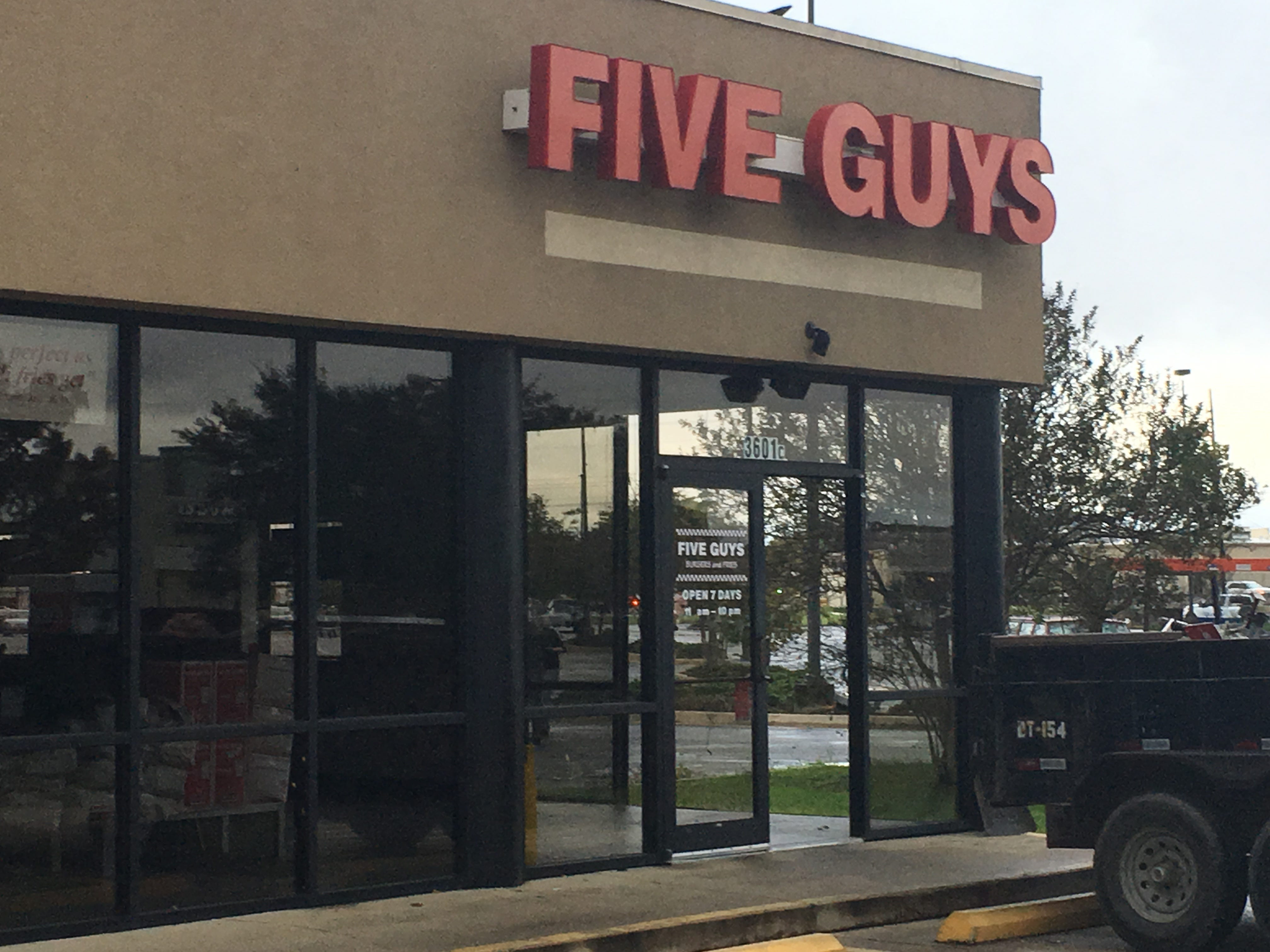The front door, a side wall and the roof were all damaged at the Five Guys restaurant on North Boulevard.