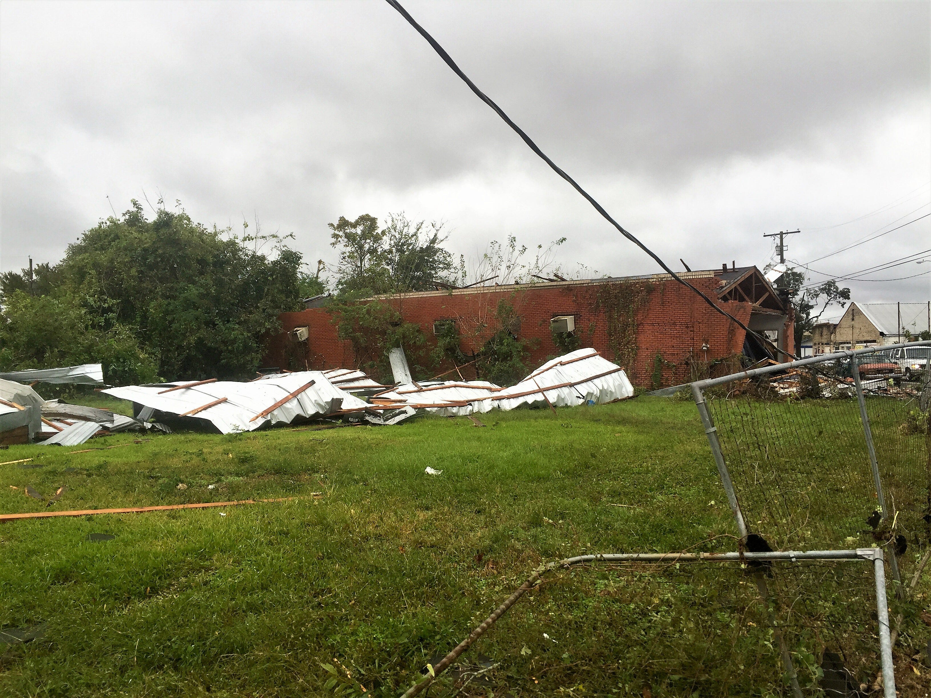 Damage in the Lee Street area from Wednesday night's storms included downed power lines and sections of buildings torn off.