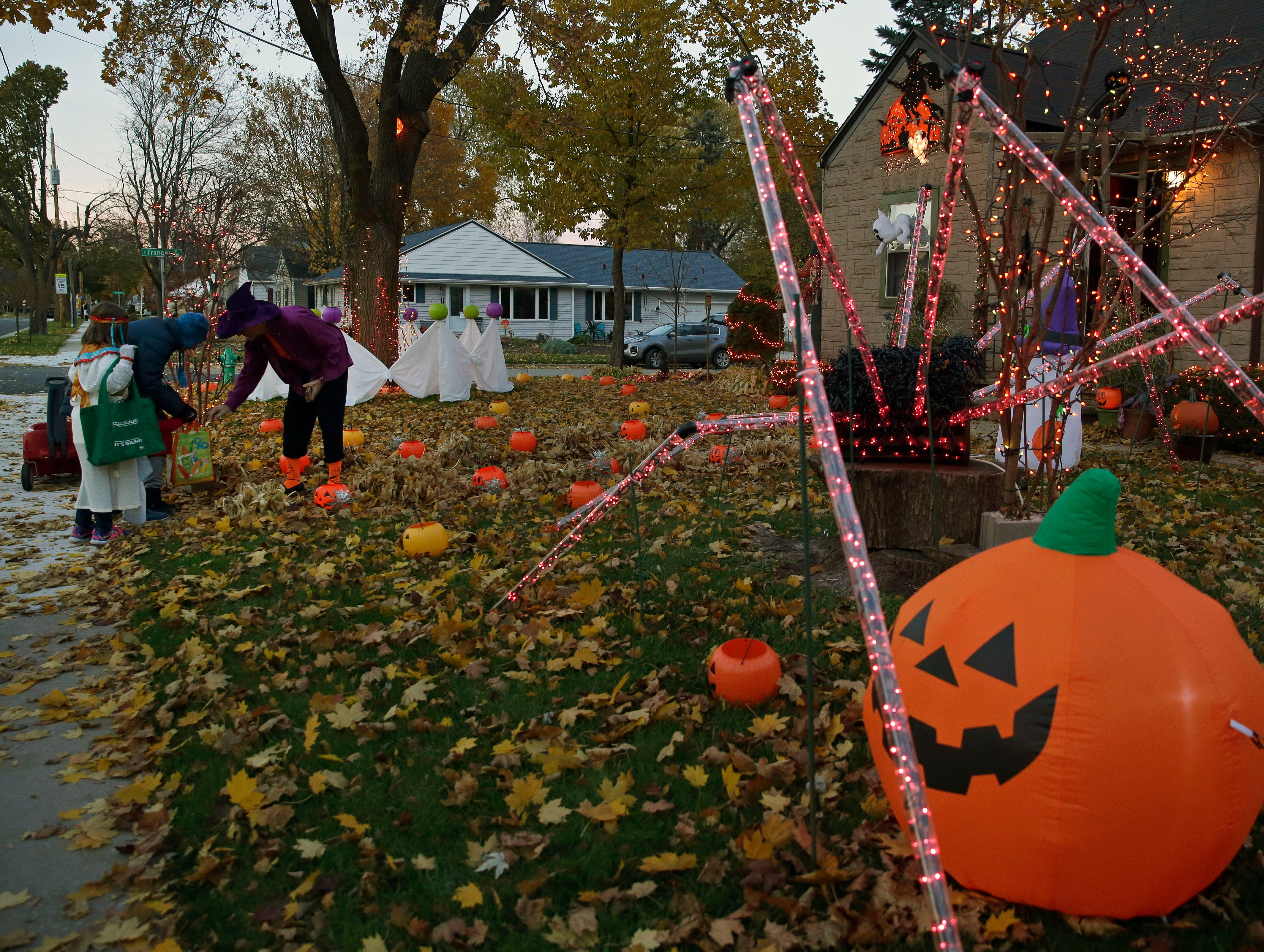Brian Kemp has his house decorated for the big day as he passes out candy to trick-or-treaters Wednesday, October 31, 2018, in Appleton, Wis.
