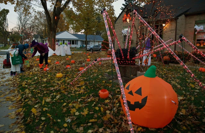 Brian Kemp has his house decorated for the big day as he passes out candy to trick-or-treaters Wednesday, October 31, 2018, in Appleton.