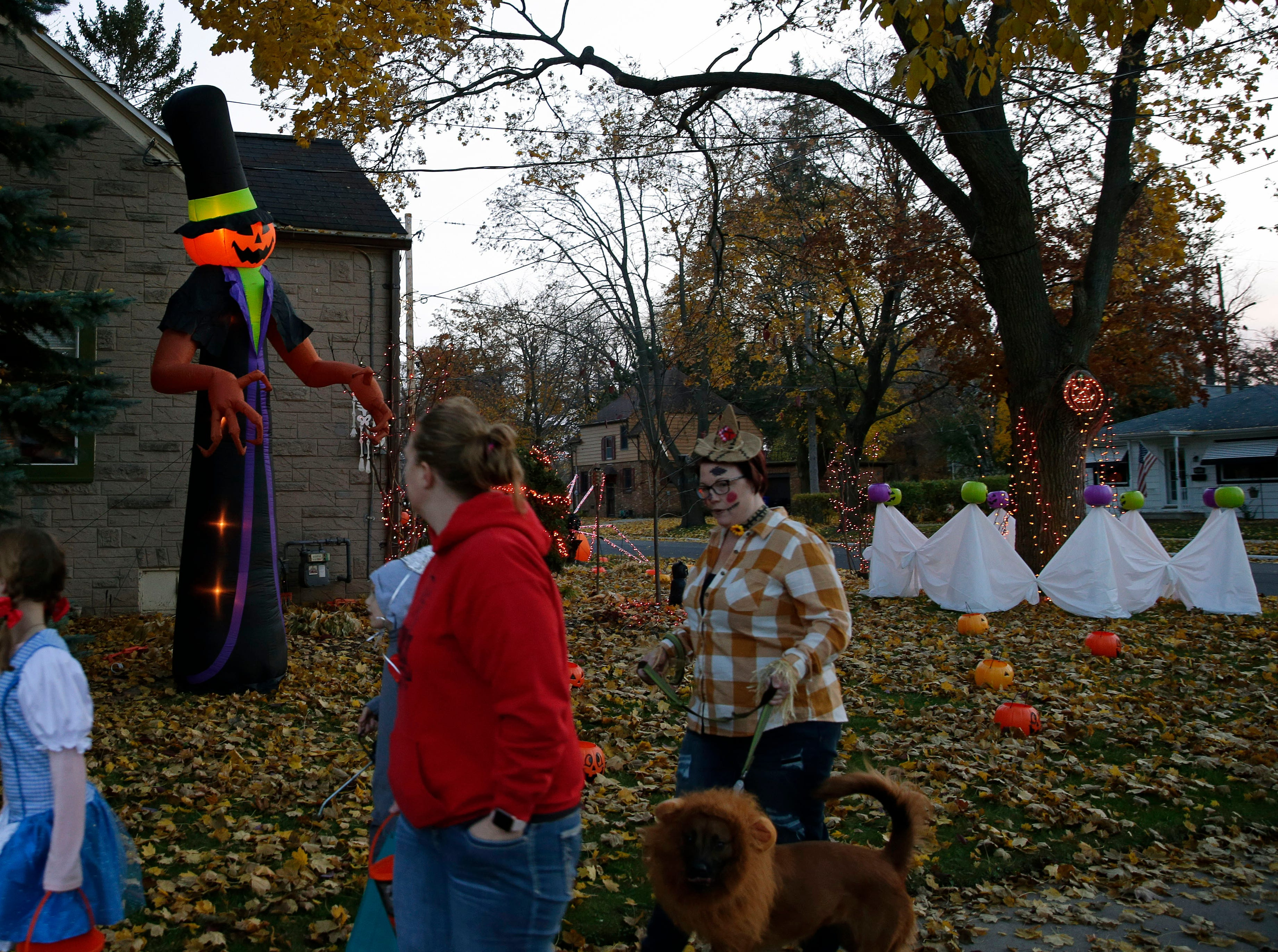 Brian Kemp has his house decorated for the big day as trick-or-treaters look at the decorations Wednesday, October 31, 2018, in Appleton, Wis.