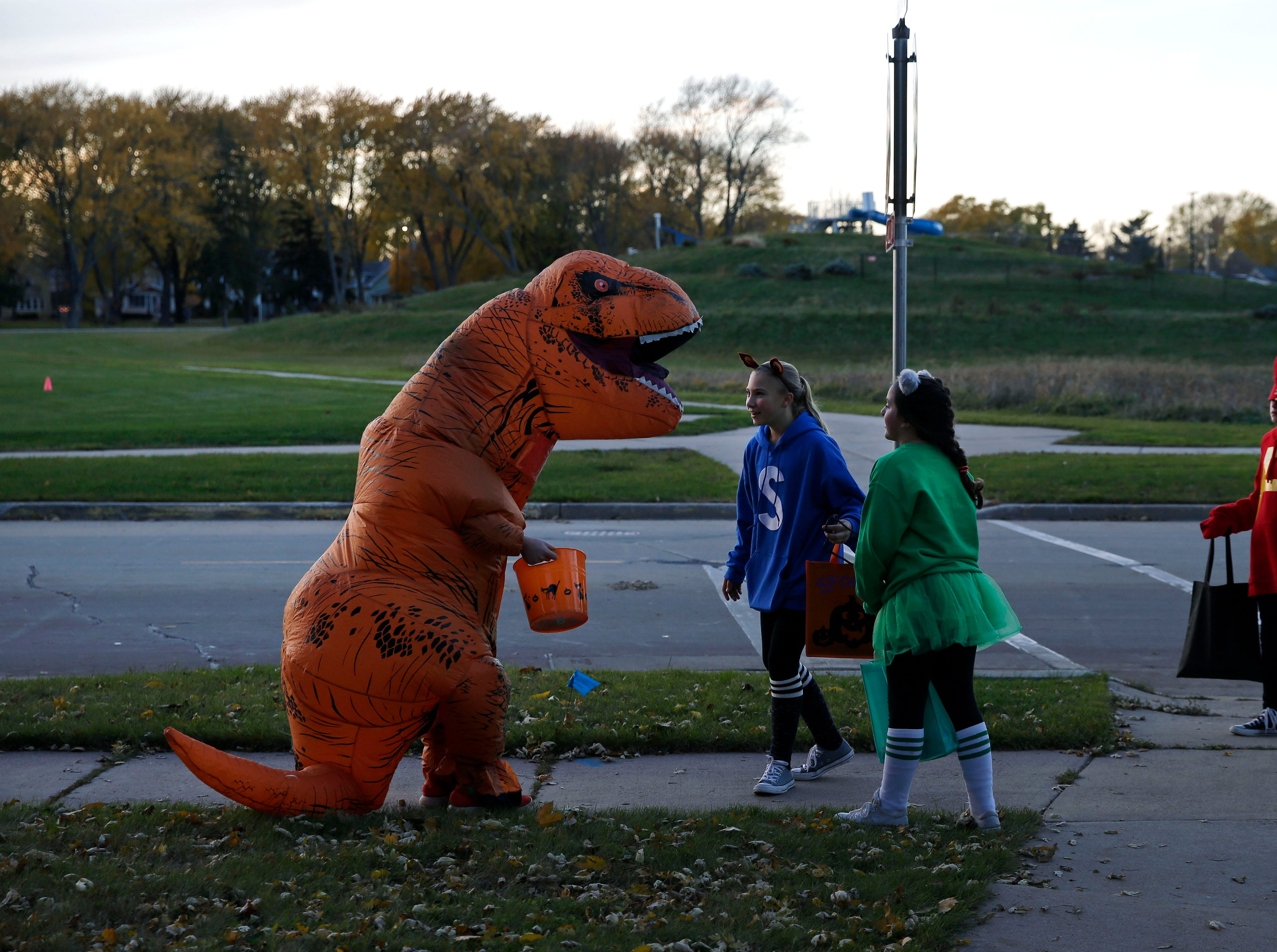 It's Halloween and trick-or-treaters figure out where to go next Wednesday, October 31, 2018, in Appleton, Wis.
