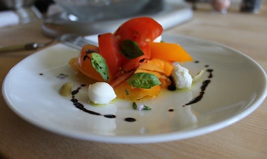 Heirloom Kitchen uses local tomatoes in its caprese salad.