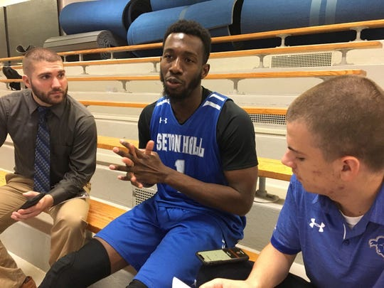 Seton Hall captain Mike Nzei talks with reporters.