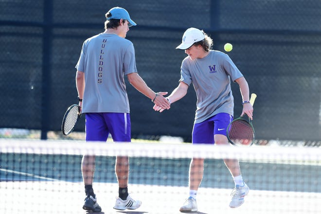 Wylie's Carson Cole, left, and Reid Heuerman high-five during the No. 3 boys doubles match in the Class 5A state semifinal against San Antonio Alamo Heights in College Station on Thursday, Nov. 1, 2018. The Bulldogs won 12-7.